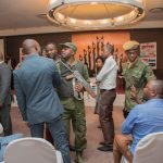 Eastern Province PF youth chairman Emmanuel Banda with his Lusaka Province counterpart Daniel Kalembe argue with police officers after the duo bused cadres to the Hotel InterContinental where they disrupted the Law Association of Zambia Bill 10 discussion on Monday evening