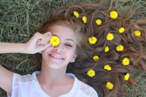 Teenager with dandelions