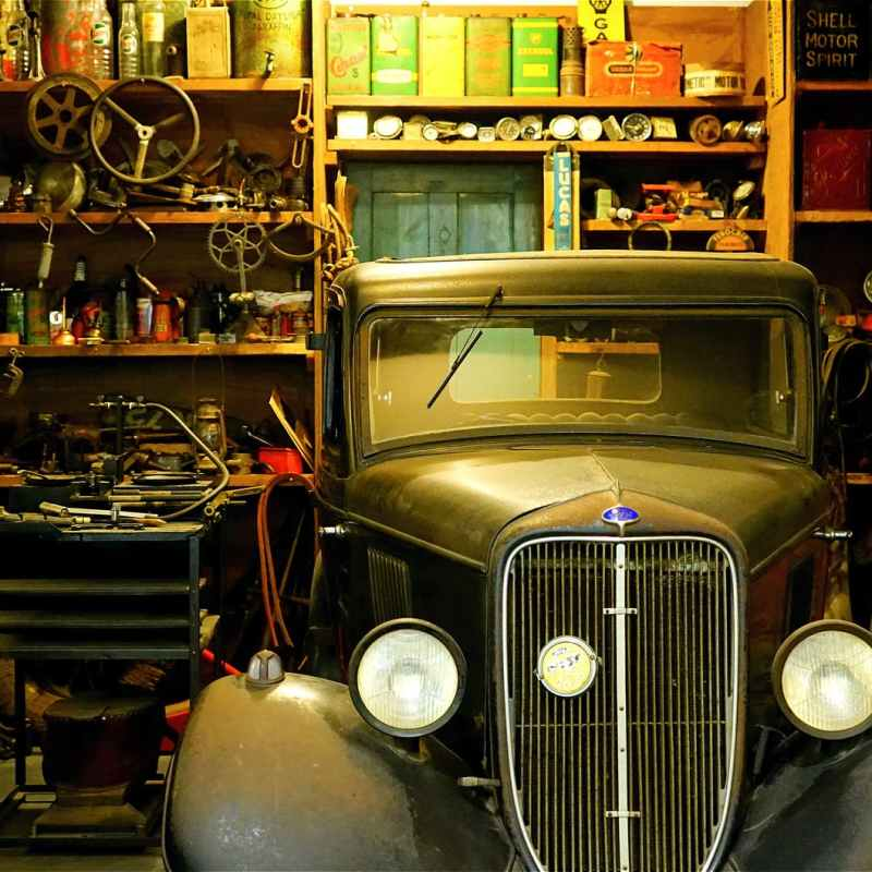 black classic car inside the garage
