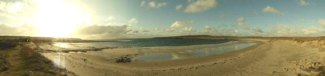 Paroramic view of the Bay of Skaill. Skara Brae visible on the left.