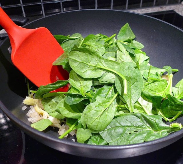 Add in fresh spinach leaves.