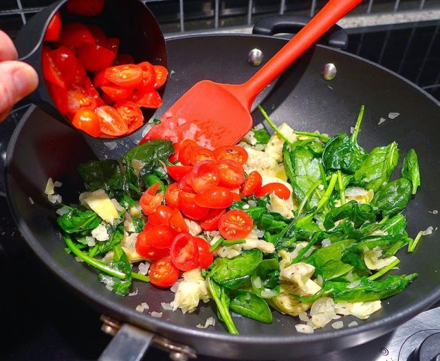 Remove vegetables from heat and stir in tomatoes.