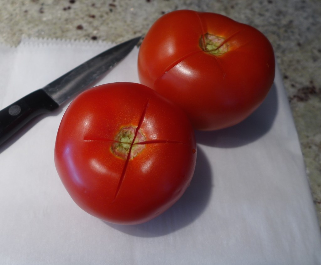 Start with ripe tomatoes. Cut an X across the top for easier peeling.