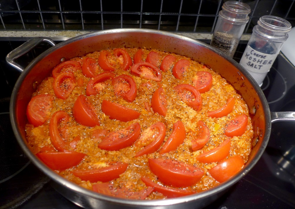Taste the paella and sprinkle tops of tomatoes with salt and pepper. Turn off oven and return paella to oven for another 5-20 minutes, until ready to eat.