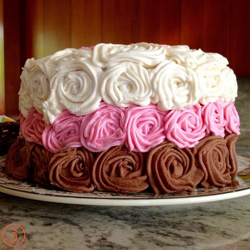 White, strawberry and chocolate rose birthday cake.