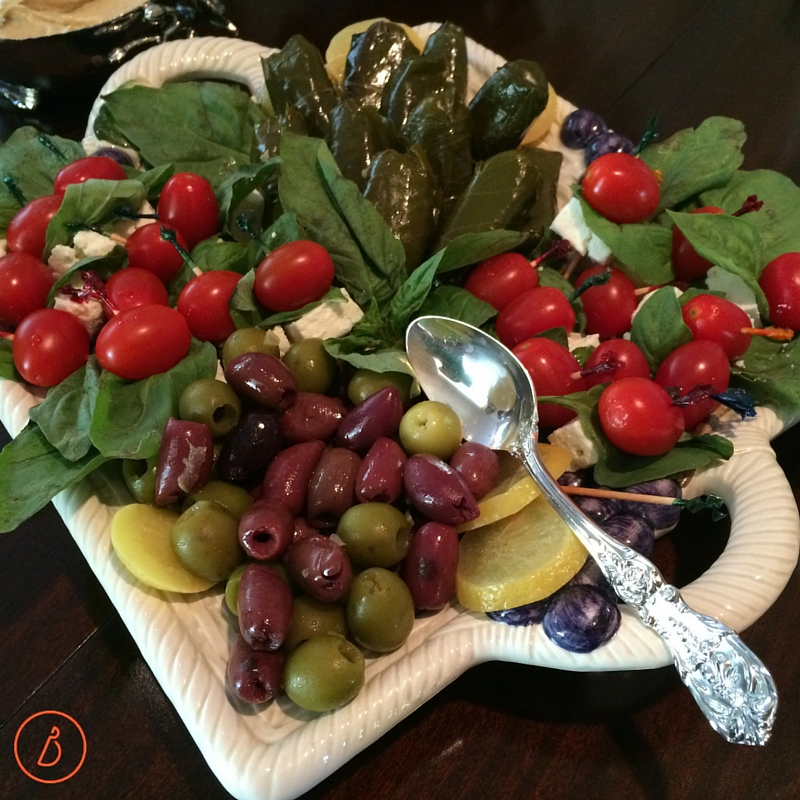 Platter of dolmas, greek olives, and feta,tomato and basil skewers