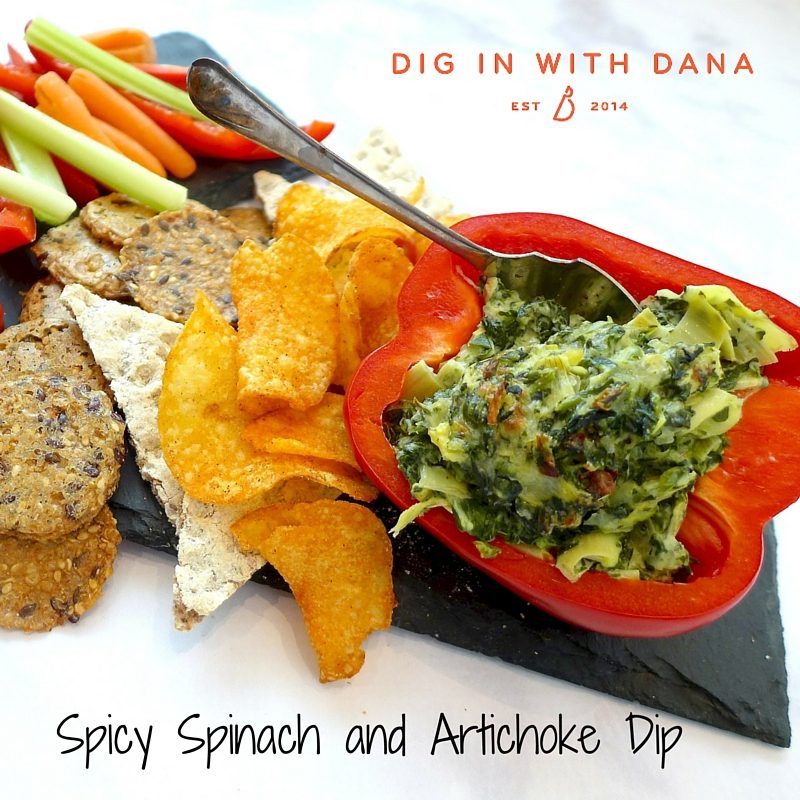 Spicy Spinach Artichoke Dip served with raw veggies, crackers and chips.