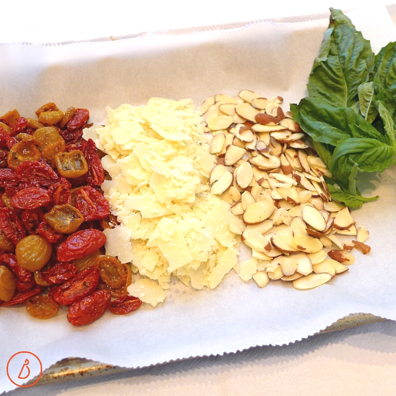 To make a delicious side or vegetarian main dish use simple, but high quality ingredients like slow roasted tomatoes, shaved parmesan, thinly sliced almonds and fresh basil