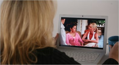 Watching movie on laptop.