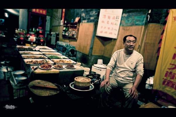 Image: Open air restaurant in Pingyao - by Blazej Mrozinski