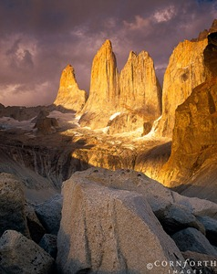 Chile, Patagonia, Torres del Paine NP, Dramatic clouds enhance a spectacular sunrise view of the Los Torres del Paine