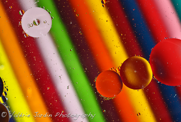 Image: Water and oil don't mix! Here the glass dish was set up over colored pencils to add inte...