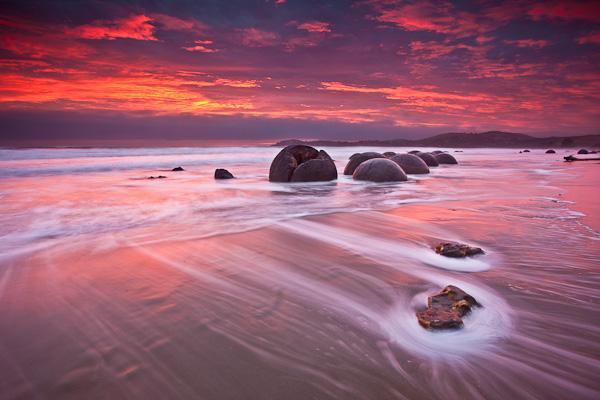 Image: Sunrise Over The Moeraki Boulders, Otago New Zealand. Seascapes lend themselves to the creati...