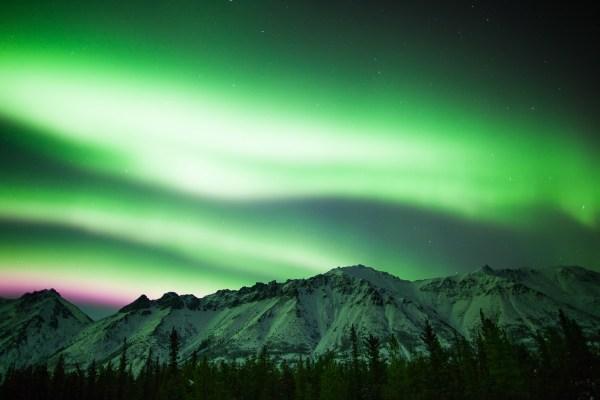 Image: Bright aurora illuminating the landscape: Canon 5D Mark II, 24mm lens, 5 secs, f1.4, ISO800