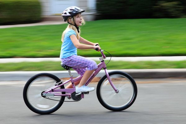 Image: Panning is a great way to capture children at play. Exposure is 1/15, f/13, ISO 100. Canon EO...