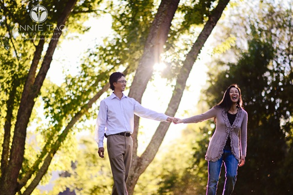 Annie Tao Photography East Bay lifestyle couple photography woman laughing while leading man with golden hour sun