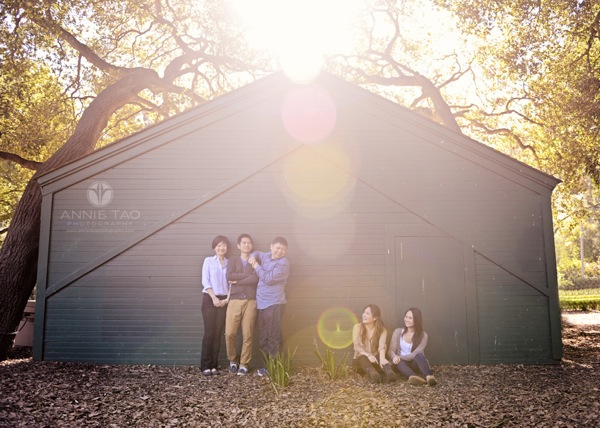 Annie Tao Photography San Francisco Bay Area family photography family against a barn with trees and sunflare