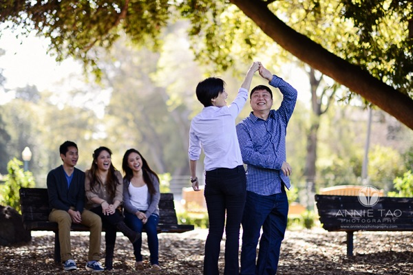 Annie Tao Photography San Francisco Bay Area lifestyle photography parents dancing while their children watch on a bench