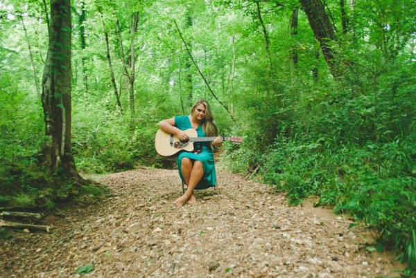 senior with guitar in woods