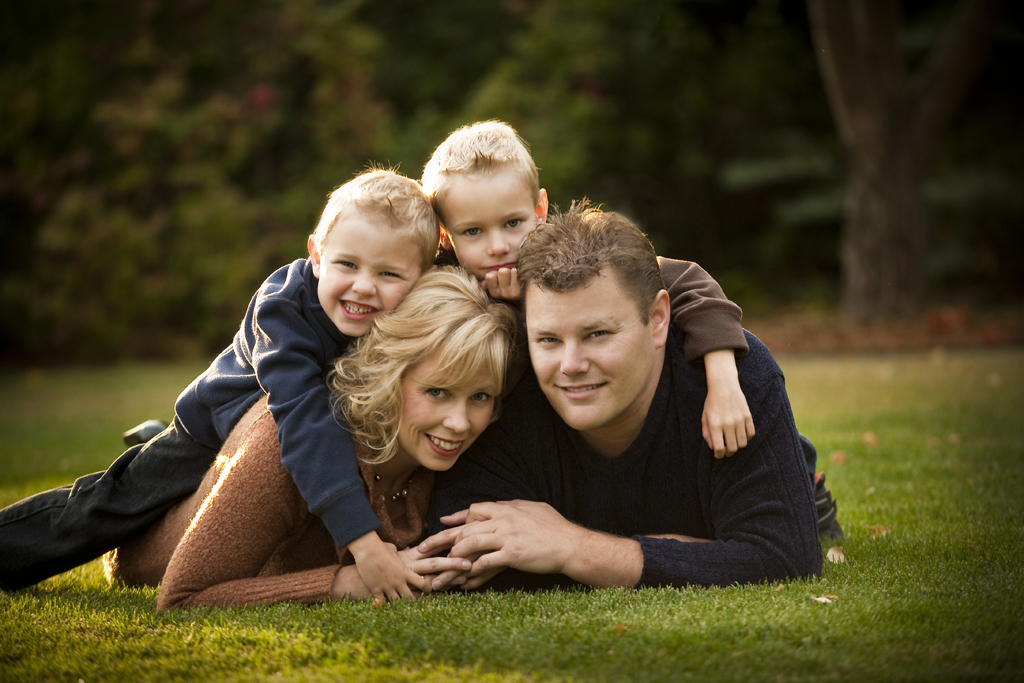The lying in the grass, pile on top pose. Great for families with small children.