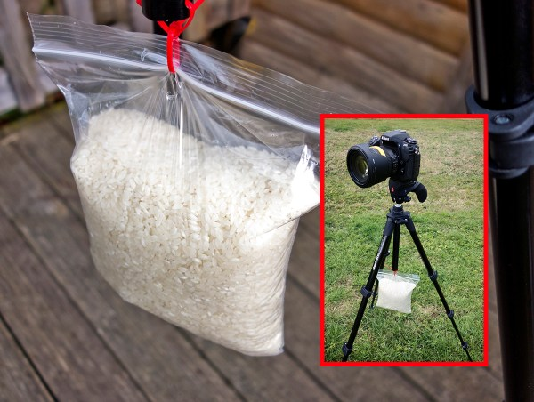 A Ziploc bag filled with 1kg of rice suspended from tripod using cable ties