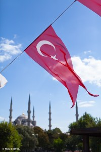 The flag in the foreground gives a completely different shot of the Blue Mosque.