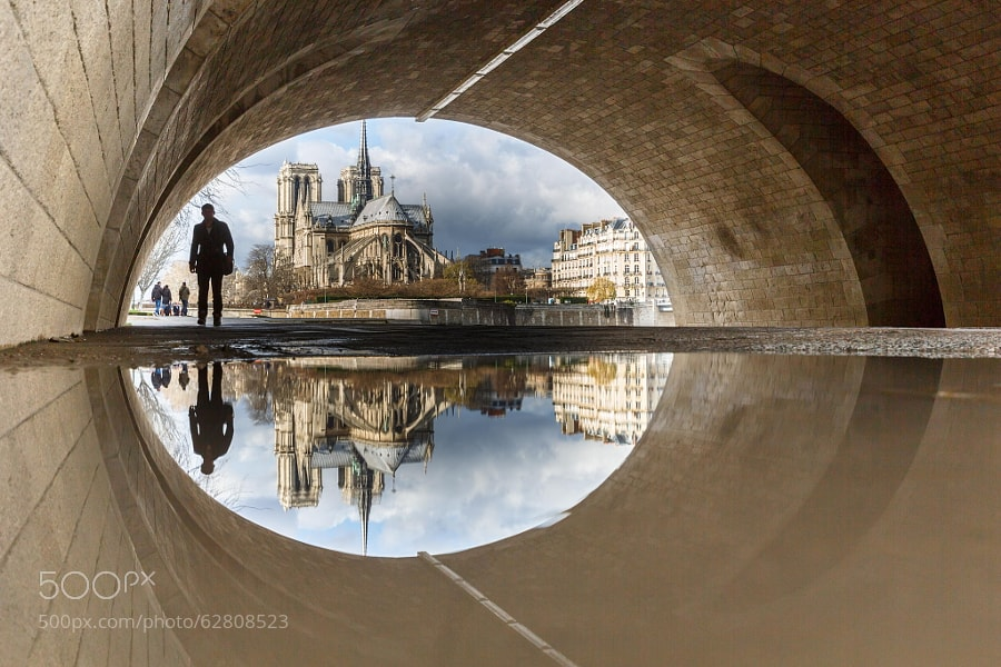 Photograph Puddle Mirror Reflection on Notre Dame by Loïc Lagarde on 500px