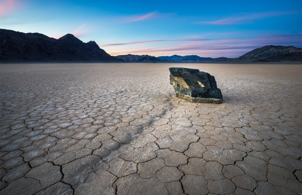 A mysterious sailing rock during sunset at the Racetrack Playa