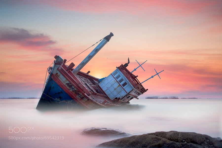 Photograph Fishing boat beached by Anek S on 500px