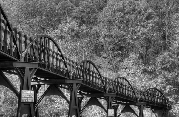 In black and white it becomes easier to see how this bridge draws the views eye
