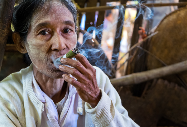 Old Burmese woman smoking a cigar
