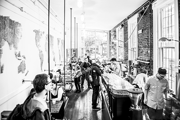 A scene in a coffee shop, taken at 24mm. Converted to B&W and edited in Photoshop