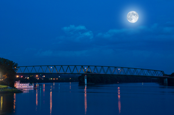 shooting the moon above a bridge at night