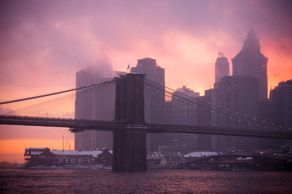 Brooklyn Bridge in Snowstorm, at Sunset