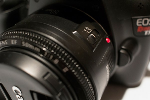 The AF-MF switch is located on the lens itself if compatible.