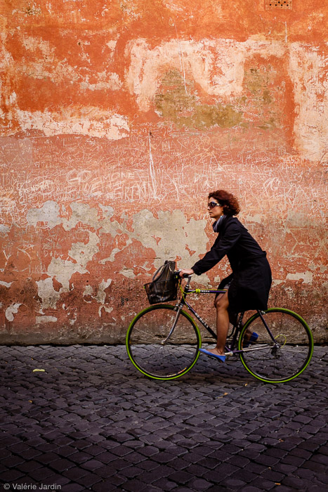 Finding a textured colorful background and waiting for the right subject to enter your frame makes for a strong color street photograph. The green tires and blue shoes  completed the shot.