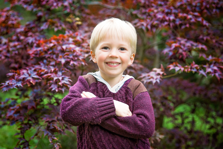 boy wearing a purple-red sweater