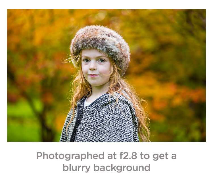 girl with blurry background using an f/2.8 shutter speed