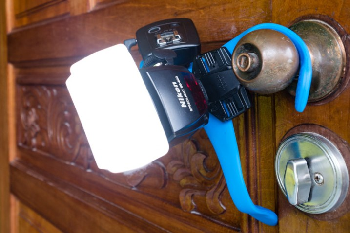 the miggo splat holding a speedlight