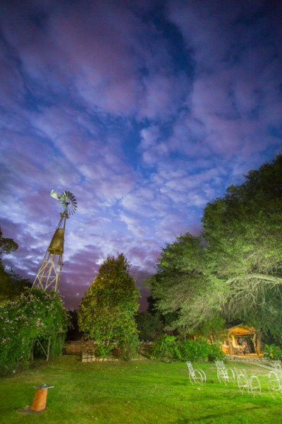 A windmill stands in the garden of the Finca Santa Anita in Salta Province, Argentina.