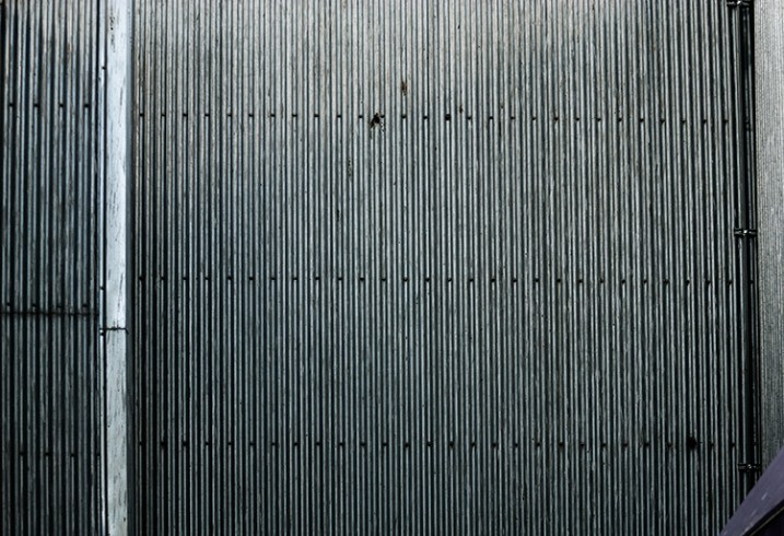 The lines and the rivets in the image make it feel uniform, as does the lack of colour