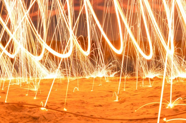 fire-spinning-beach-sparks
