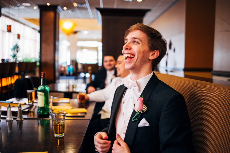 man laughing at a table