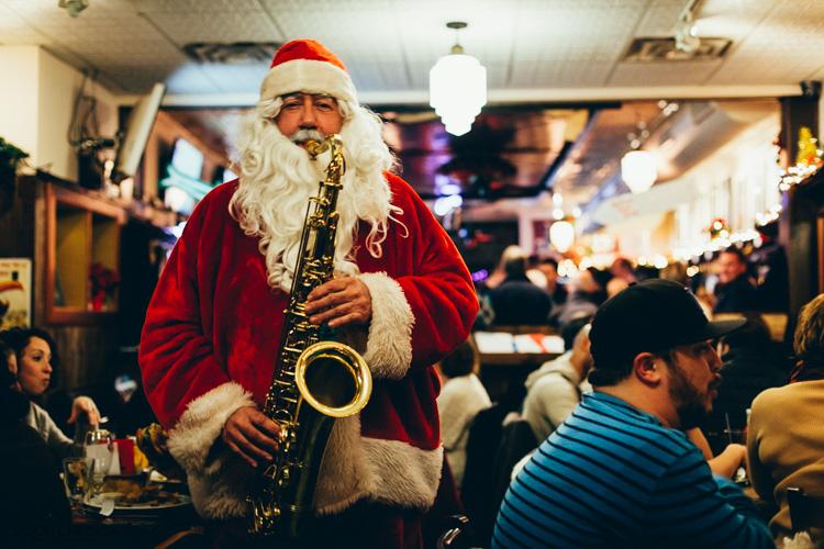 man playing the saxophone as Santa