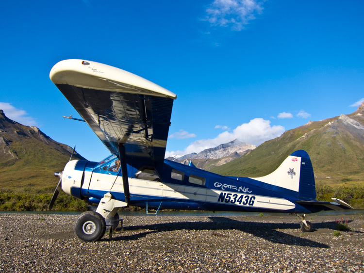 A DeHaviland Beaver, classic Alaska bush plane on a riverside gravel bar in the Brooks Range of northern Alaska.