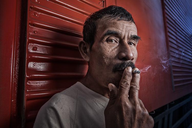 dockworker smoking wide-angle portrait