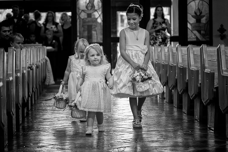 24-120mm. Shot at 120mm, 1/160, f/4, ISO 1400. Knowing how the lens behaves at both ends of the zoom, I knew I could use this lens for wide angle shots in close, but zoom in as the flower girl was coming down the aisle and still get an interesting shot.