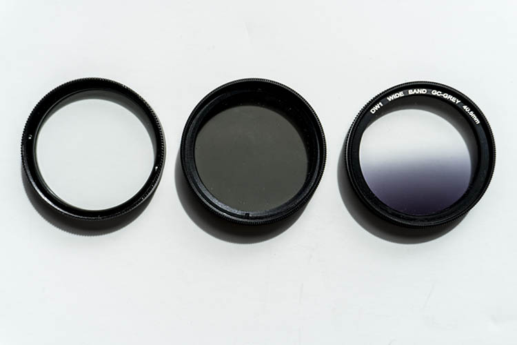 From left to right: A clear UV filter, a polarizing filter, and a Graduated Neutral Density filter.