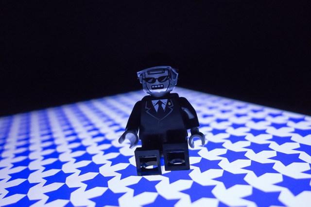 lego-figure-blue-stars-background