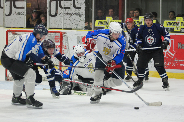 An sports action shot of hockey players fighting for the puck